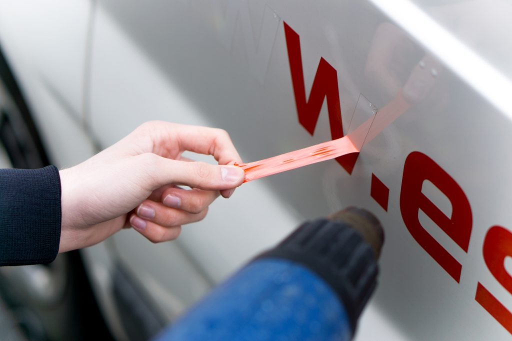 Image of a person removing a decal sticker