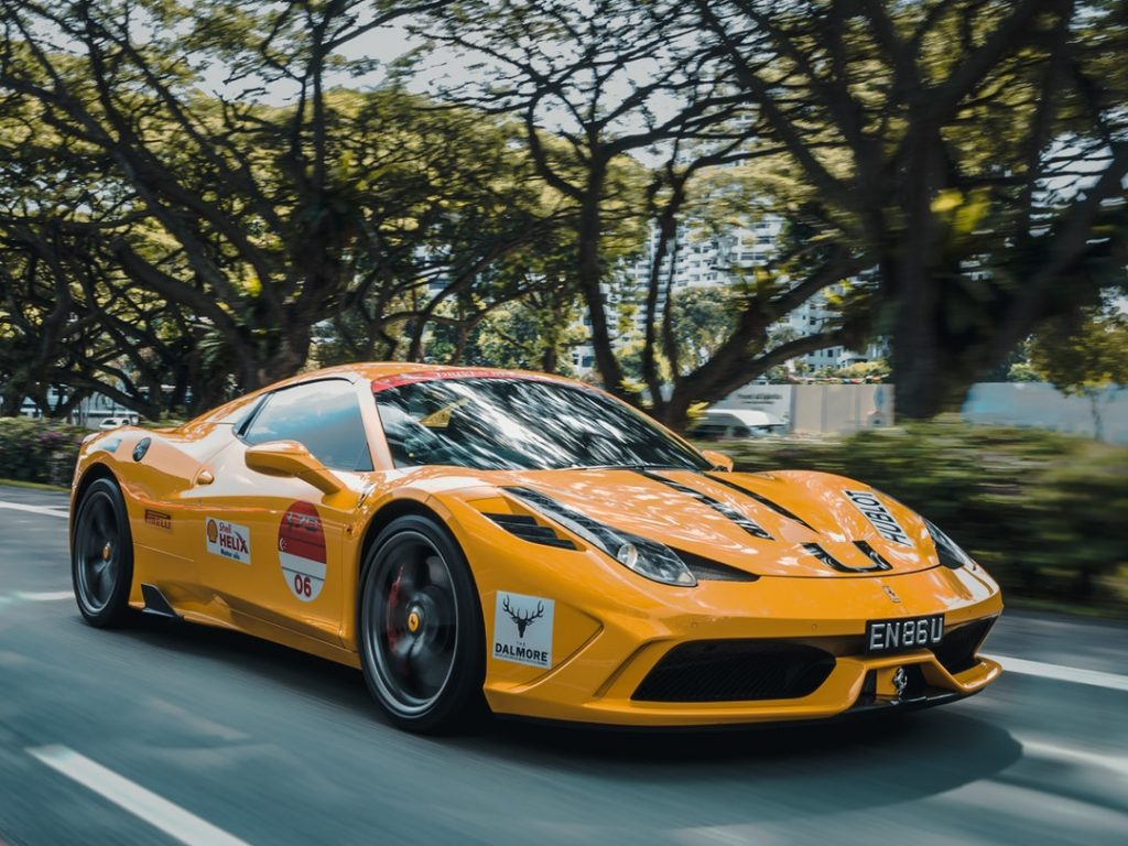 Image of an orange racing Ferrari with decal stickers